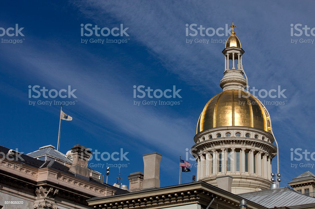 New Jersey State Capitol Building Golden Dome in Trenton Gold dome of the New Jersey State Capitol Building in Trenton on a beautiful spring day. Off center for copy space Architectural Column Stock Photo