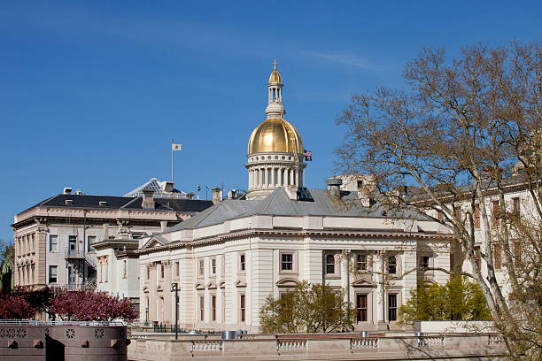 New Jersey State Capitol Building Golden Dome in Trenton Gold dome of the New Jersey State Capitol Building in Trenton on a beautiful spring day. Off center for copy space capital cities stock pictures, royalty-free photos & images