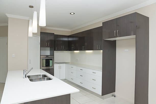 New kitchen with granite bench and tiled floor stock photo