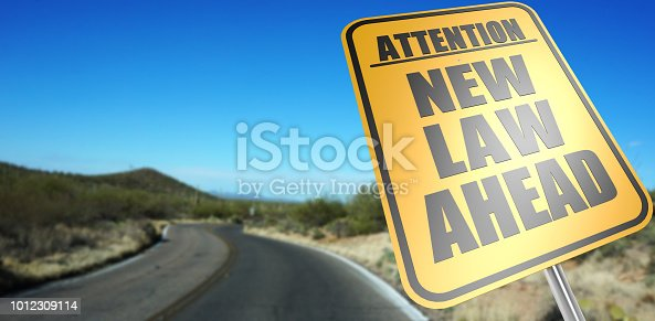 New law ahead road sign on a sky background and dessert road