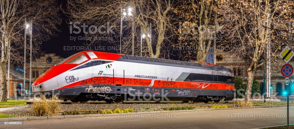 New locomotive representing the history of rail transport, near the former repair workshops for rail vehicles (1895), now venue for cultural events - foto stock
