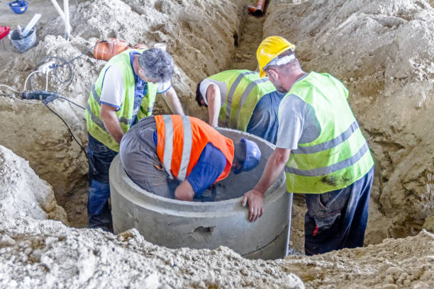 New manhole is under construction. Zrenjanin, Vojvodina, Serbia -June 29, 2015: Work is in progress. Building activities during construction of the large complex shopping mall