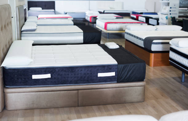 new mattresses on the beds in the store stock photo