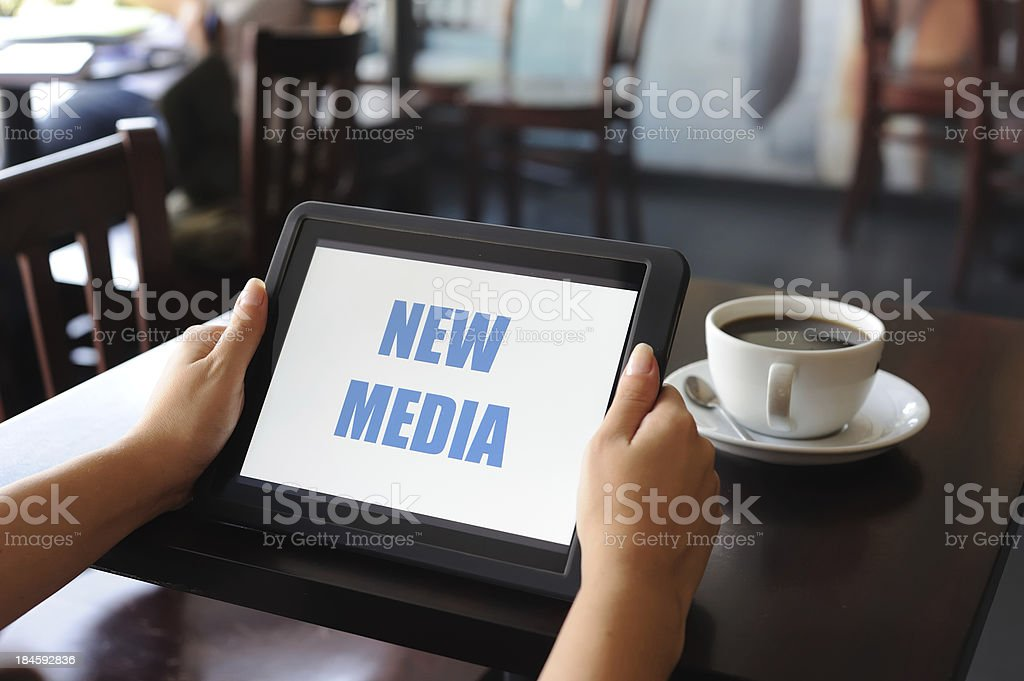 New Media on digital tablet stock photo