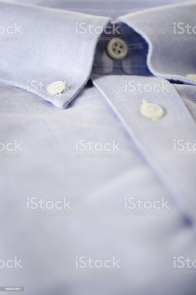 New Men's Blue Button-down Shirt Close-up stock photo