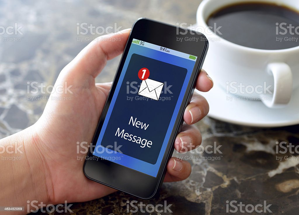 New message on smart phone stock photo