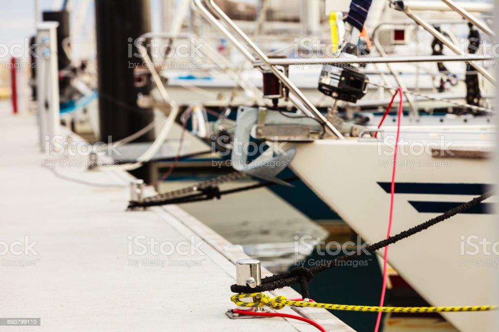 New metal harbor marina bolts with ropes stock photo
