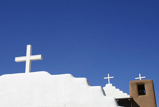 New Mexican adobe church with blue sky stock photo