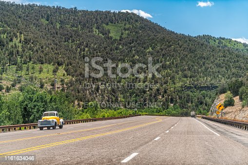 Glencoe, USA - June 8, 2019: New Mexico road view in Lincoln National Forest on 70 west by Sacramento and Gallinas Mountains and vintage car