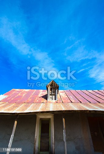 New Mexico: Old Abandoned House with Traditional Pitched Tin Roof