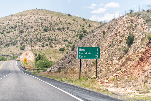 New Mexico, USA countryside rural road view from 380 highway with desert landscape and sign for Hondo, San Patricio and Ruidoso