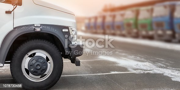 1140988145 istock photo New middle size trucks at dealership parking outdoors at winter. Truck service and maintenance. Delivering and warehouse service 1078730458