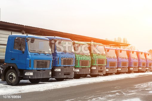 1140988145 istock photo New middle size trucks at dealership parking outdoors at winter. Truck service and maintenance. Delivering and warehouse service 1078769594