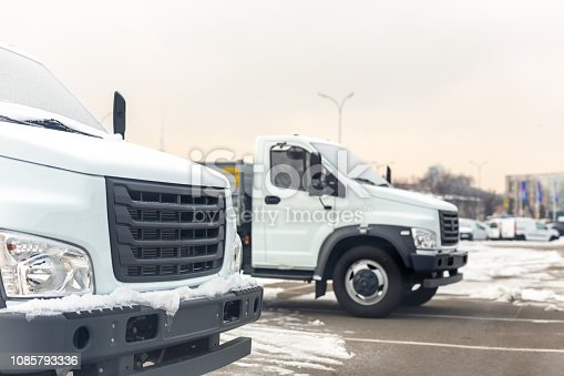1140988145 istock photo New middle size trucks at dealership parking outdoors at winter. Truck service and maintenance. Delivering and warehouse service 1085793336