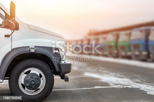 1140988145 istock photo New middle size trucks at dealership parking outdoors at winter. Truck service and maintenance. Delivering and warehouse service 1085793342