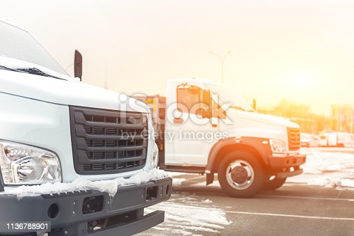 1140988145 istock photo New middle size trucks at dealership parking outdoors at winter. Truck service and maintenance. Delivering and warehouse service 1136788901