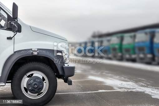 1140988145 istock photo New middle size trucks at dealership parking outdoors at winter. Truck service and maintenance. Delivering and warehouse service 1136788902