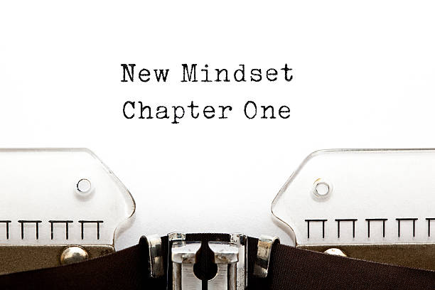 new mindset chapter one typewriter - attitude stock photos and pictures