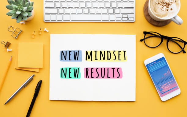 New mindset new results concepts with text on notepad on desk. positive thinking stock photo