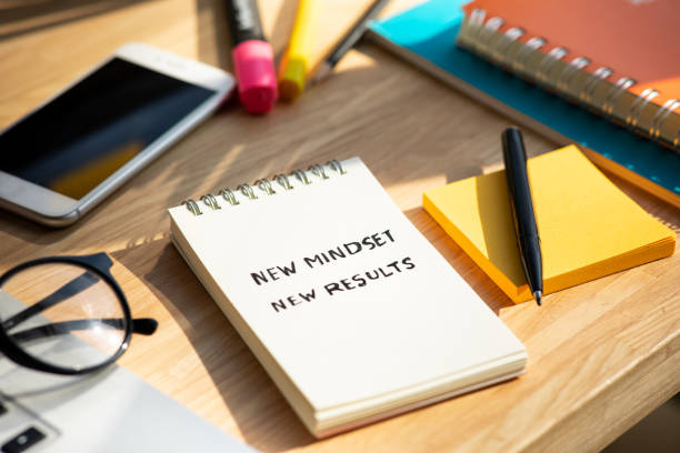New mindset new results concepts with text on notepad on desk stock photo