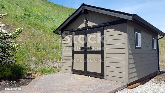 Vernon, British Columbia,Canada- May,19,2019: Stand alone shed complete with door and windows and electricity.  Looks good with siding and roof.