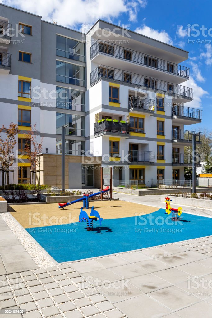 New modern apartment building with children's playground royalty-free stock photo
