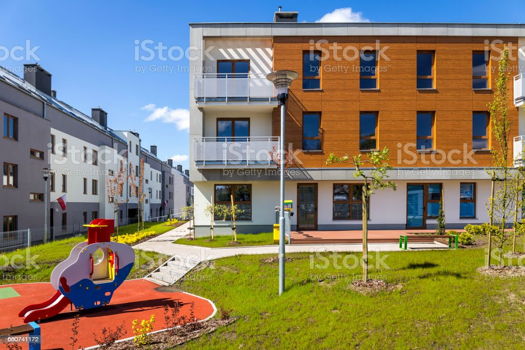 New modern apartment building with playground stock photo