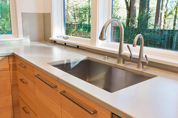 new modern clean kitchen counter with sink - kitchen sink stock photos and pictures
