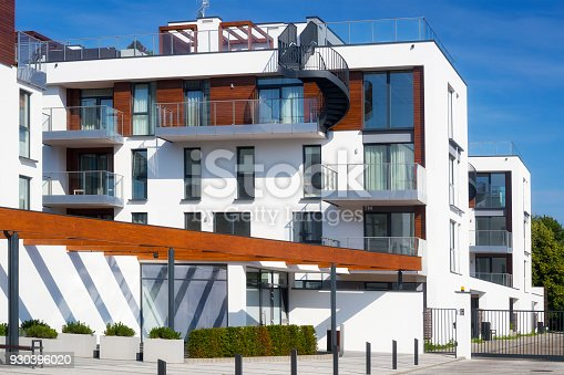889473004 istock photo New modern complex of apartment buildings with white facade 930396020