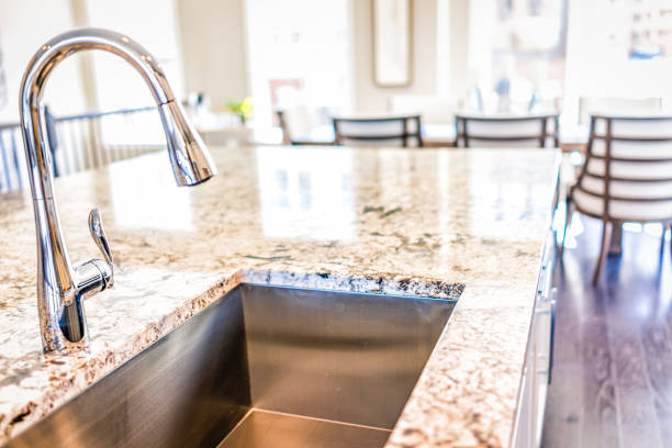 New modern faucet and kitchen room sink closeup with island and in picture id861063056?b=1&k=6&m=861063056&s=612x612&w=0&h=48uxpxkw8fpuylqaby x9xyxkmtikf7gr9vchsv1ilw=