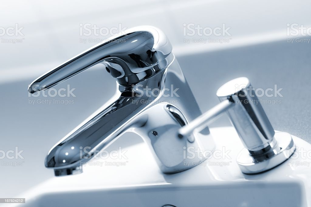 new modern faucet stock photo