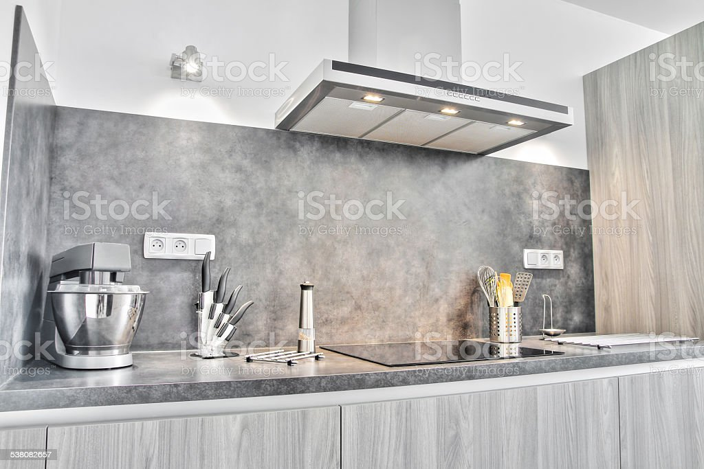 New modern gray kitchen with utensils stock photo