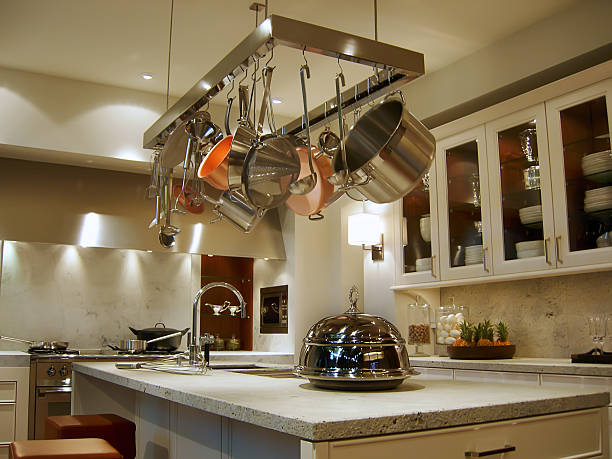 New, modern kitchen with a rack of hanging pots and pans stock photo