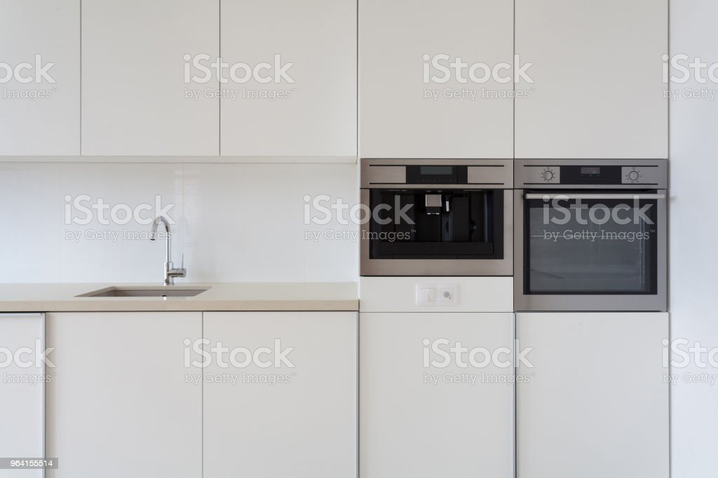 New Modern White Kitchen With Built In Oven And Chrome Water Tap Stock Photo Download Image Now Istock