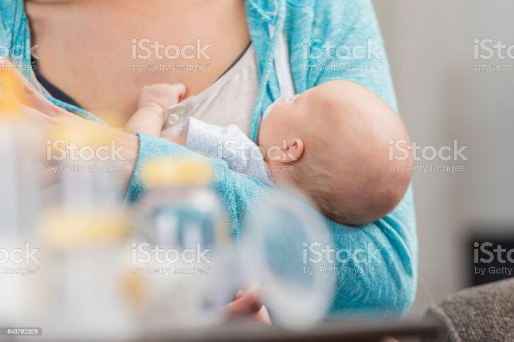 New mom cradles her newborn baby girl stock photo