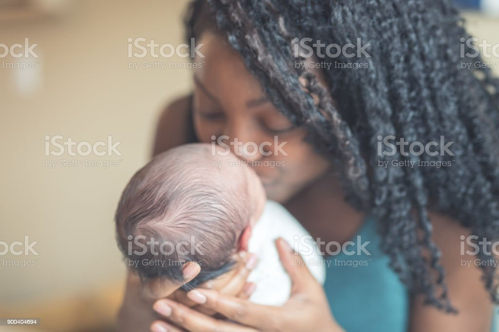 New Mom Holding Infant Daughter stock photo