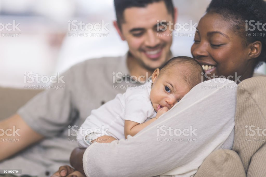 New Mom Holds Her Infant to Her Chest stock photo