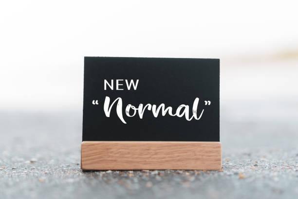 new mormal word on black board concept background. - new normal foto e immagini stock