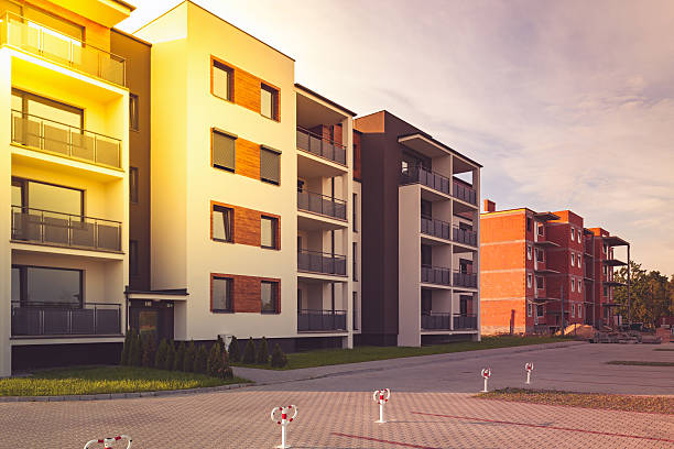 New multi-family block with balconies, bright facade and wooden panels. stock photo