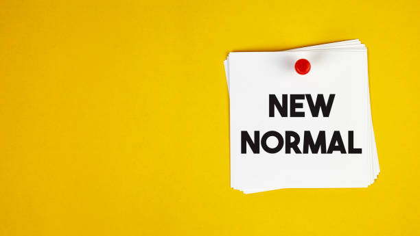 New Normal After Coronavirus. Pinned Paper with New normal message on the Yellow Background. stock photo