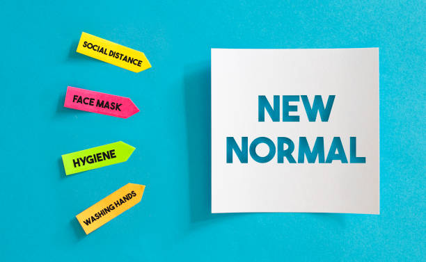 New Normal After Coronavirus. Sticky Paper with New normal message on the Blue Background. stock photo