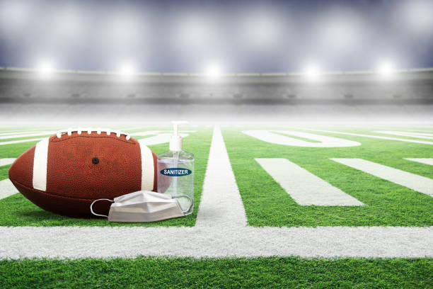 New Normal in Football Game Played in Empty Stadium During COVID-19 stock photo