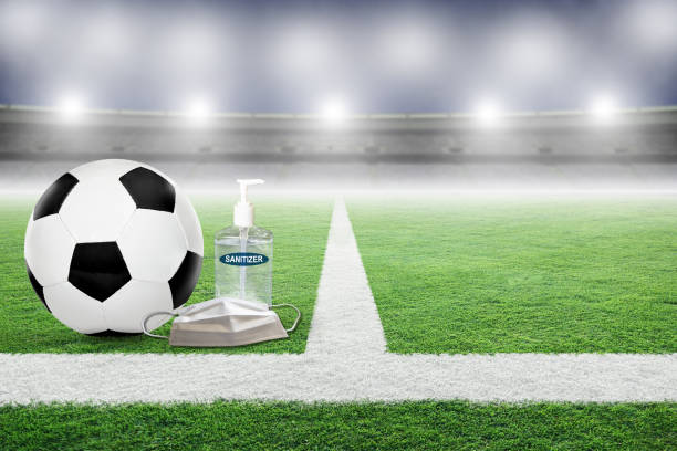 New Normal in Soccer Game Played in Empty Stadium During COVID-19 stock photo