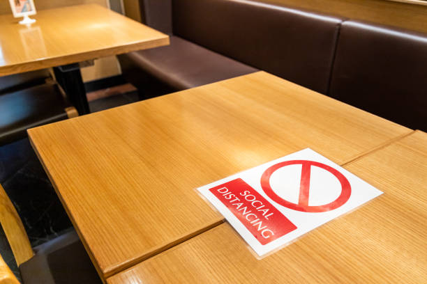 New normal with table signage prohibit occupancy to maintain social distance stock photo
