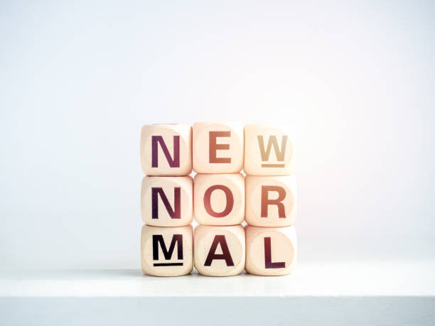 new normal, word on wooden alphabet cube - new normal foto e immagini stock