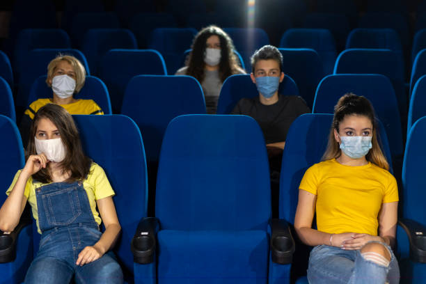 COVID-19 new normality in cinema. Audience in cinema. stock photo