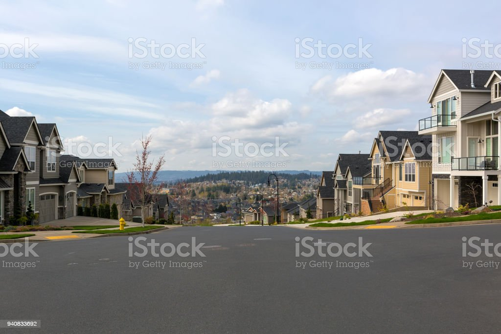 New North American suburban neighborhood upscale homes along street in Happy Valley OR USA stock photo