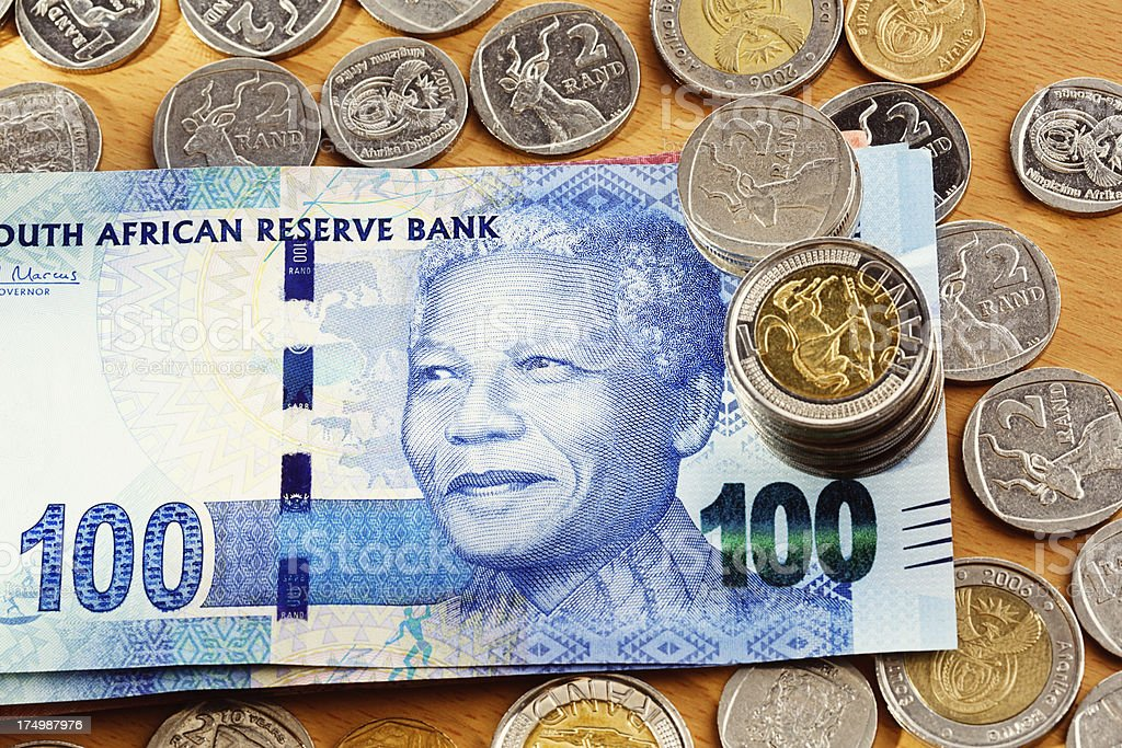 New One Hundred Rand Mandela banknote on desk with coins royalty-free stock photo