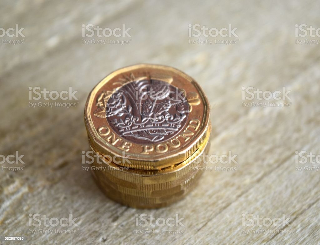 new one pound coin British currency close up stock photo