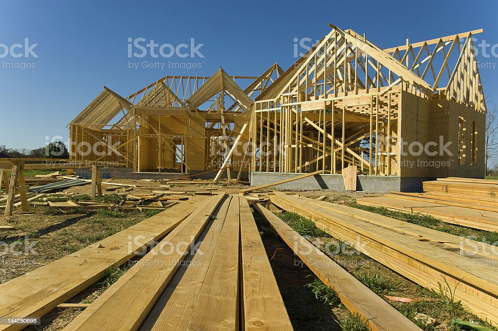 New one story home under construction on sunny day stock photo